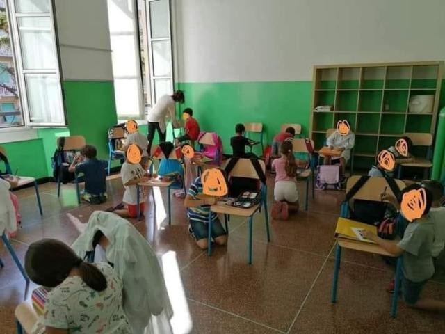 bambini-senza-banchi-studiano-in-ginocchio